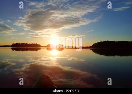 Sunset reflections. Lake Kukkia, Luopioinen, Finland. 24.6.2018 - Stock Photo