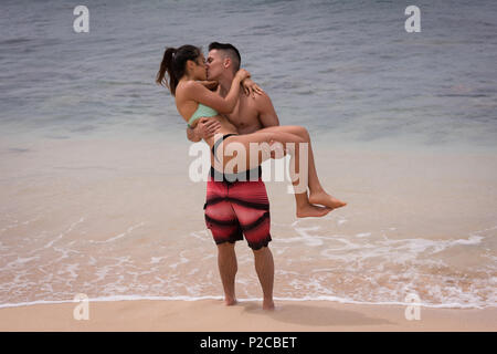 Couple kissing each other in the beach - Stock Photo