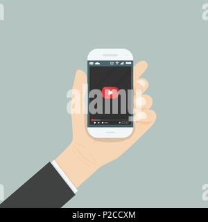Hand holding smartphone with video player for website on the screen.Mobile applications isolated background.Mobile video player icon.Internet search e - Stock Photo