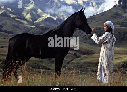 Original Film Title: THE YOUNG BLACK STALLION.  English Title: THE YOUNG BLACK STALLION.  Film Director: SIMON WINCER.  Year: 2003.  Stars: BIANA TAMIMI. Credit: KENNEDY/MARSHALL COMPANY, THE/MOONLIGHTING FILMS/WALT DISNEY / GURR, DAVID / Album - Stock Photo