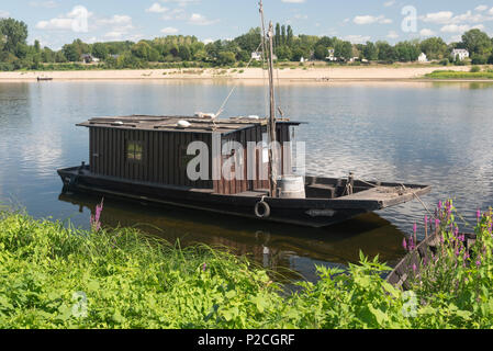 Wooden house boat moored on the Loire river - Stock Photo