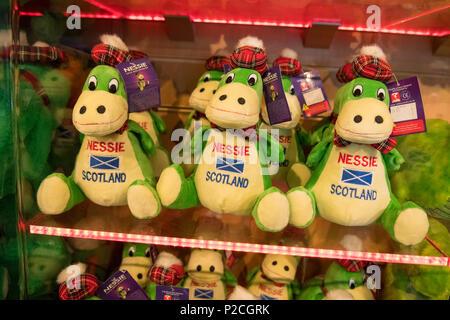 Nessie - Loch Ness Monster souvenirs on sale at the Loch Ness Centre & Exhibition gift shop, Drumnadrochit, Scotland, UK - Stock Photo