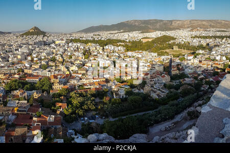 Athens, Greece cityscape viewed from the Acropolis with Lycabetous hill in the background - Stock Photo