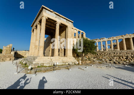 Temple ruins on the Acropolis in Athens in Greece and shadows of tourists taking photos - Stock Photo