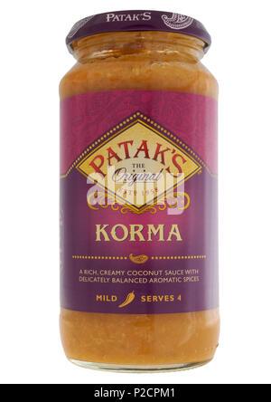 Jar of Patak's korma sauce on white background - Stock Photo