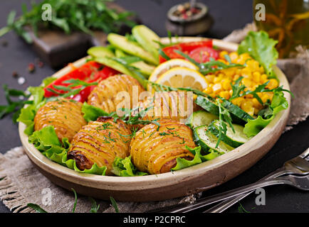 Vegetarian buddha bowl. Raw vegetables and baked potatoes in  bowl. Vegan meal. Healthy and detox food concept. - Stock Photo