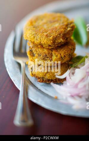 India, Kerala state, Kochi, breaded meat croquette - Stock Photo