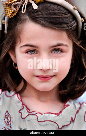 Azerbaijan, Baku, Heydar Aliyev park, a young girl visits the Flower Festival - Stock Photo