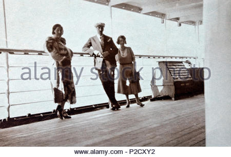 people on the walking deck of a large cruise passenger ship 1930s - Stock Photo