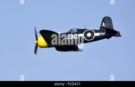 Goodyear FG-1D Corsair from The Fighter Collection flying at Shuttleworth Fly Navy airshow on 3rd June 2018 - Stock Photo