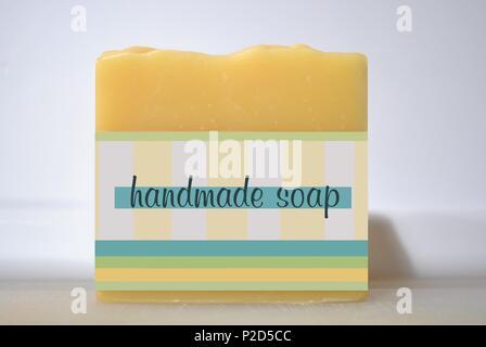 Handmade Soap – A Yellow Bar of Handmade Soap - Stock Photo