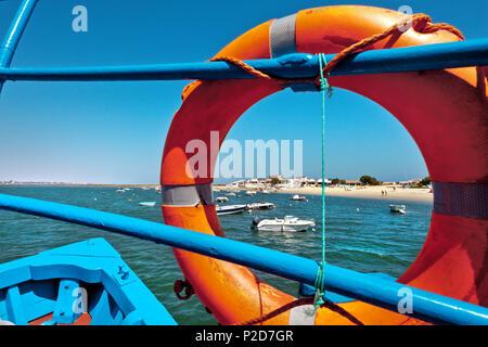 Ferry boat to Armona island, View through lifebuoy, Olhao, Algarve, Portugal - Stock Photo