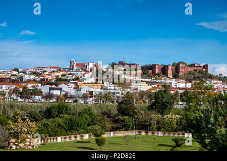 View towards old town, castle and cathedral, Silves, Algarve, Portugal - Stock Photo