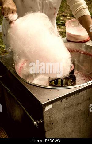 cotton candy made in old machine for kids day in the park - Stock Photo