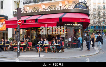 Typical traditional parisian cafe Danton located on Saint Germain boulevard. Saint Germain boulevard known for its cafes serving traditional dishes. - Stock Photo