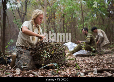 United States Army 2nd Lt. Sara Vagie makes a fish trap during the survival phase of Exercise Kowari, being held in the Daly River region of the Northern Territory, on 4 September 2016. Kowari is an Australian army-hosted survival skills exercise designed to increase defense cooperation between forces from the U.S., Australia and China. (Australian Defence Force photo by Cpl. Jake Sims) - Stock Photo