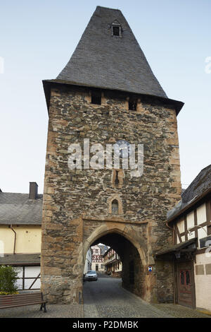 Half-timbered houses and gateway of the 12th century clock tower in Herrstein, Administrative district of Birkenfeld, Region of - Stock Photo