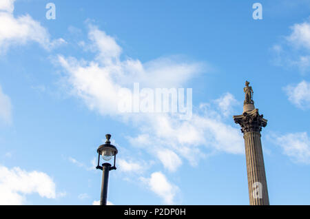 Low angle view of Nelson's Column against the sky at Trafalgar Square, London - Stock Photo