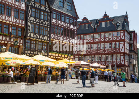 Half-timbered buildings with outdoor seating at restaurants on Roemerberg square, Frankfurt am Main, Hessen, Germany, Europe - Stock Photo