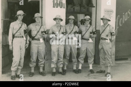 Vintage 1944 photograph, the 'town patrol' in Natal, Brazil of soldiers from Natal Air Force Base. This facility had an important role during World War II as a strategic base for aircraft flying between South America and West Africa. SOURCE: ORIGINAL PHOTOGRAPH. - Stock Photo