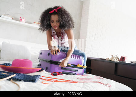 African American Girl Preparing Baggage For Vacation And Travel - Stock Photo