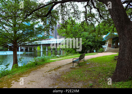 City of Austin has beautiful parks with walking trails, paths, park benches, large oak shade trees, along the river downtown Austin TX - Stock Photo