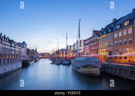 Nyhavn with the canal at night in Copenhagen city, Denmark. - Stock Photo