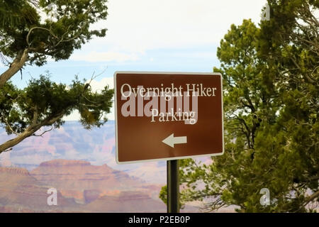 An overnight hiker parking sign at the Grand Canyon. - Stock Photo