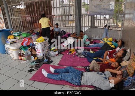 Families from Guatemala and Mexico seeking asylum in the United States wait for many days at the port-of-entry in Nogales, Sonora, Mexico for US offic - Stock Photo