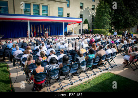 160909-N-ZI635-007  WASHINGTON (Sept. 9, 2016) Attendees listen to opening remarks during an observance ceremony to commemorate the 15th anniversary of the September 11, 2001 attack on the Pentagon. The Pentagon Memorial, located on Boundary Channel Drive in Arlington, Va., commemorates the 184 lives lost at the Pentagon headquarters and on-board American Airlines Flight 77 during the terrorist attacks. (U.S. Navy photo by Mass Communication Specialist 2nd Class George M. Bell/Released) - Stock Photo
