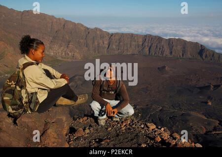 Cape Verde, Fogo, Pico de Fogo, Moutain guides on the top of the volcano and in front of his caldeira - Stock Photo