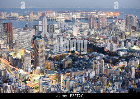 Odaiba, Bay and Rainbow Bridge seen from above during blue hour in autumn, Minato-ku, Tokyo, Japan - Stock Photo