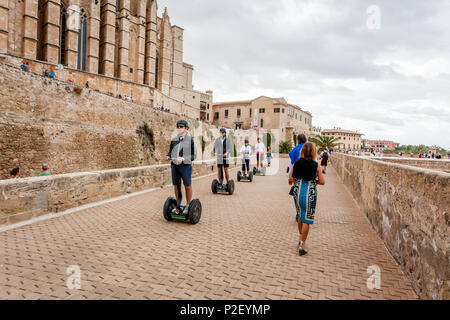 Tourists on the segwayz at the Dalt Murada in the old town of Palma, Palma, Mallorca, Spain, Europe - Stock Photo