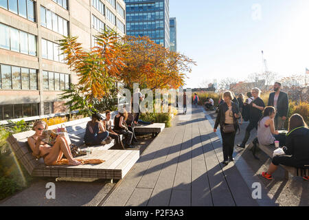 People walking along the High line, an elevated section of a disused New York Central Railroad, downtown, Manhattan, New York Ci - Stock Photo