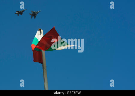 Two California Air National Guard F-15C Eagles fly over a Bulgarian Flag near the flightline at Graf Ignatievo, Bulgaria, Sept. 8, 2016. Four of the 194th Expeditionary Fighter Squadron's F-15C Eagles will conduct joint NATO air policing missions with the Bulgarian air force to police the host nation's sovereign airspace Sept. 9-16, 2016. The squadron forward deployed to Graf Ignatievo from Campia Turzii, Romania, where they serve on a theater security package deployment to Europe as a part of Operation Atlantic Resolve. (U.S. Air Force photo by Staff Sgt. Joe W. McFadden) - Stock Photo