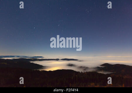 Starry sky over fog in the Rhine valley, view from Schwarzwaldhochstrasse, Black Forest, Baden-Wuerttemberg, Germany - Stock Photo