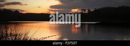 view to lake cathie nsw from the perch hole on sunset. sunset over water. stunning lake and reflections. - Stock Photo