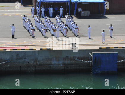 COLOMBO, Sri Lanka (Sept. 1, 2016) A Sri Lanka Navy band plays music as the submarine tender USS Frank Cable (AS 40) concludes its port visit, Sept. 1.  The visit was aimed at building friendship and goodwill between the U.S. and the people of Sri Lanka.  Frank Cable is one of two forward-deployed submarine tenders and is on a scheduled deployment in the US. 7th Fleet area of operations to conduct maintenance and support deployed U.S naval force submarines and surface vessels in the Indo-Asia-Pacific region.   (U.S. Navy Photo by Mass Communication Specialist Seaman Josh Coté/Released) - Stock Photo