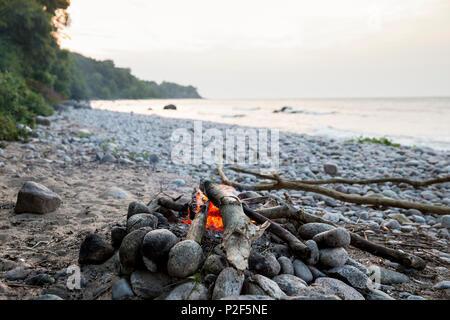 Campfire on the beach, adventure, outdoor, holiday, Baltic sea, Bornholm, near Gudhjem, Denmark, Europe - Stock Photo