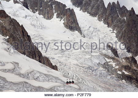 Mont Blanc panoramic view cable car on way from Aiguille du Midi France up to Punta Helbronner on Italian side, across Vallee Bl - Stock Photo