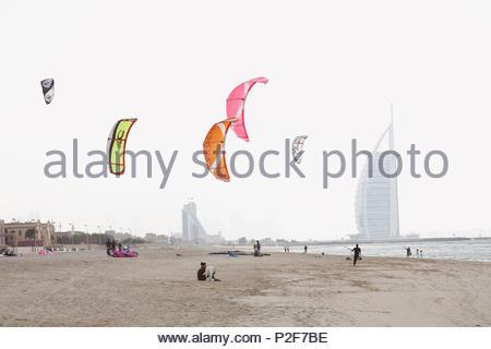 Kite surfers on the beach, Burj Al Arab in the background, Dubai, United Arab Emirates - Stock Photo