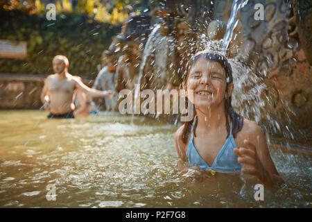 8 year old girl, Hot Springs Air Panas Banjar at Bubunan, Bali, Indonesia - Stock Photo