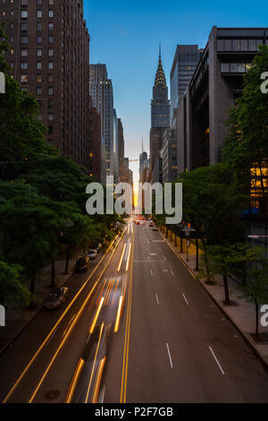 Manhattanhenge when the sun sets along 42nd street in NY - Stock Photo