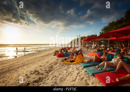Guests in beach bar, Gili Trawangan, Lombok, Indonesia - Stock Photo