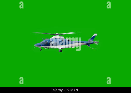 White and blue helicopter in flight, before landing with landing gear down, isolated on chroma green background - Stock Photo