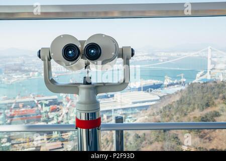 Ulsan, Korea - February 9, 2017 : Telescope and cityscape at Ulsan Bridge Observatory - Stock Photo
