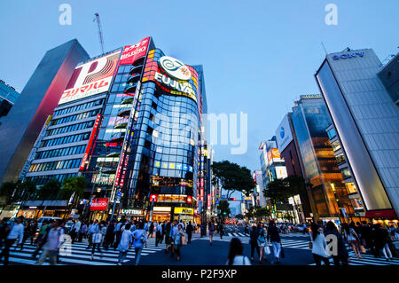 Sukiyabashi Crossing with pedestrians in Ginza at blue hour, Chuo-ku, Tokyo, Japan - Stock Photo