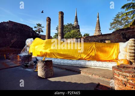 Big Lying Buddha statue in Wat Yai Chai Mongkol monastery in Ayuttaya, Thailand - Stock Photo