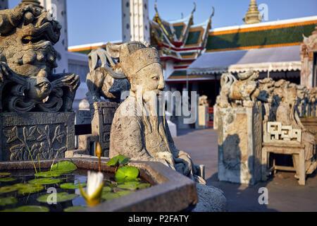 Stone statue of monk in Buddhist Temple Wat Arun in Bangkok, Thailand - Stock Photo