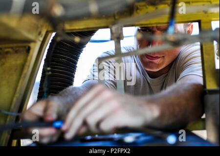 Senior Airman Bryan Hurley, a communication navigation system specialist with the 15th Aircraft Maintenance Unit, performs maintenance in the nose of an MC-130H Combat Talon II at Hurlburt Field, Fla., Sept. 21, 2016. Communication navigation system specialists are tasked to inspect, remove and install integrated avionics systems on aircraft. (U.S. Air Force photo by Airman 1st Class Joseph Pick) - Stock Photo